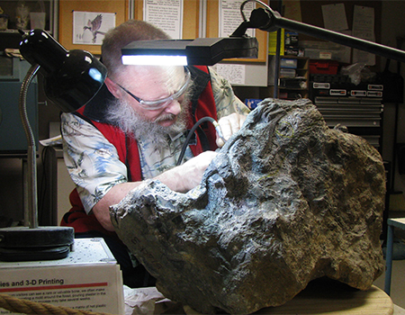 Greg Carr working on his fossil, Bernie