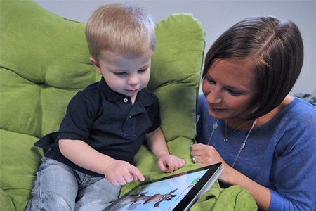 Child and Mother with iPad