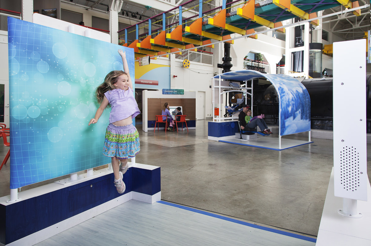 Girl jumping in Human Plus exhibit