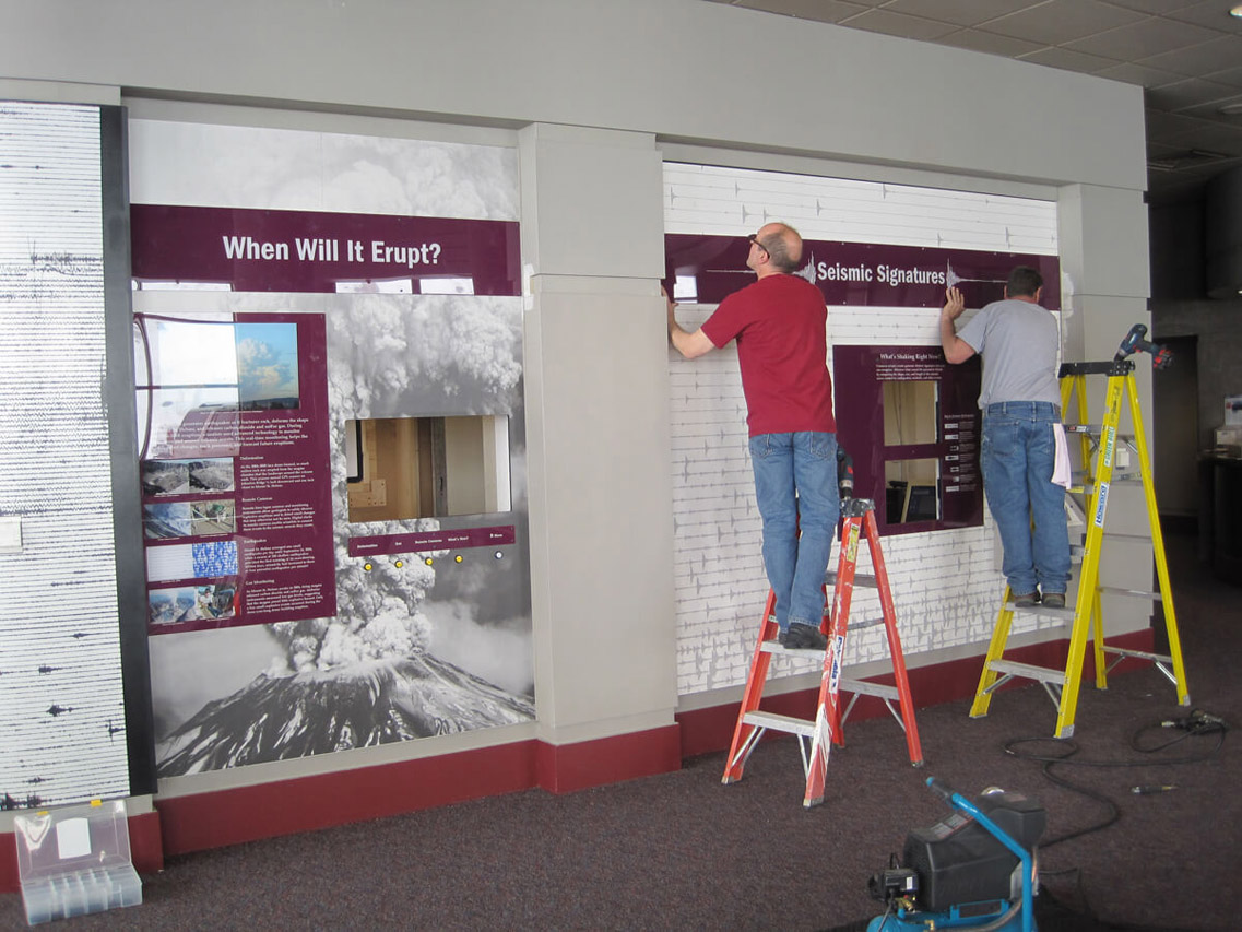 Workers install the Seismic Signatures panel
