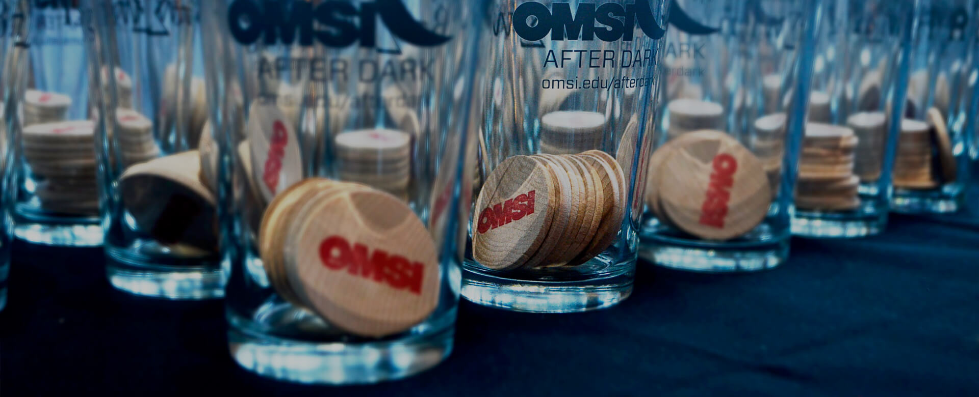 OMSI After Dark pint glasses with tokens