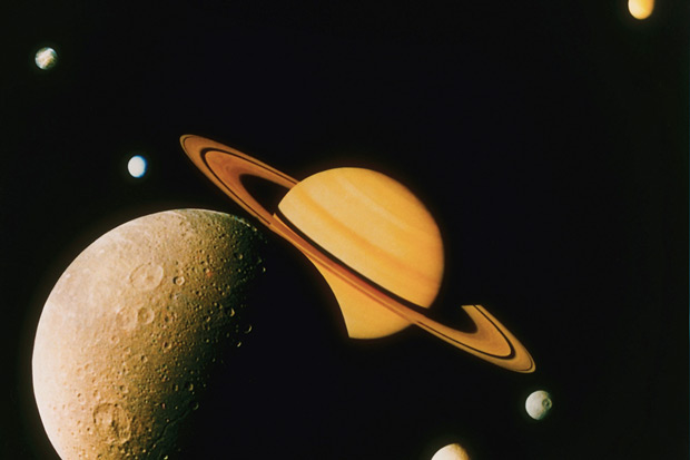 Artist image of Saturn and its moons