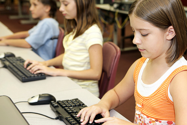 Students using keyboards in computer lab