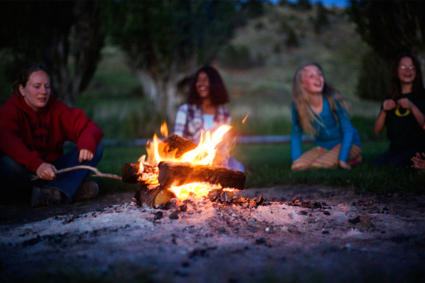 Students around evening campfire at Coastal Discovery Center
