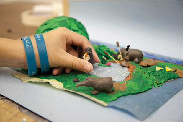 Student preparing claymation models for animation
