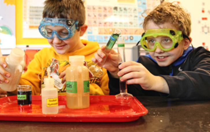 Visitors performing an experiment in the Chemistry Lab