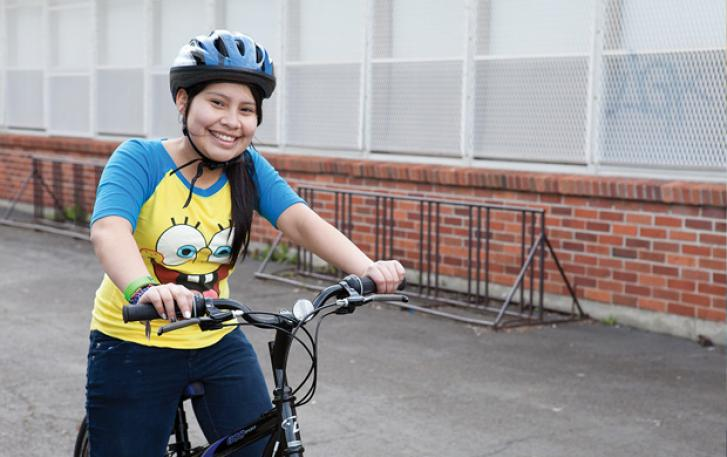 Youth cyclist with bicycle and helmet