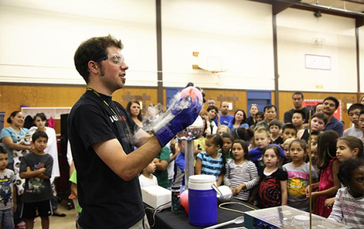 OMSI educator performing experiment at Chemistry Assembly
