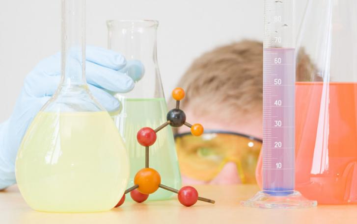 Scientist with chemistry beakers