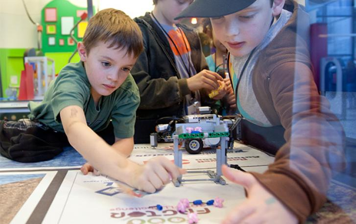 Students programming robots in an OMSI classroom.