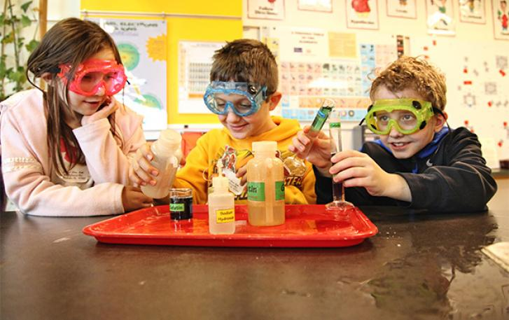 Students performing experiments in OMSI Chemistry Lab