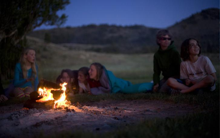 Students around campfire at Hancock Field Station