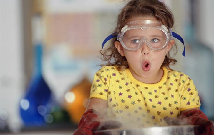 Child chemist with lab goggles