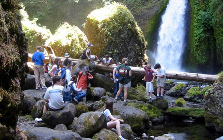 Student hiking group with waterfall