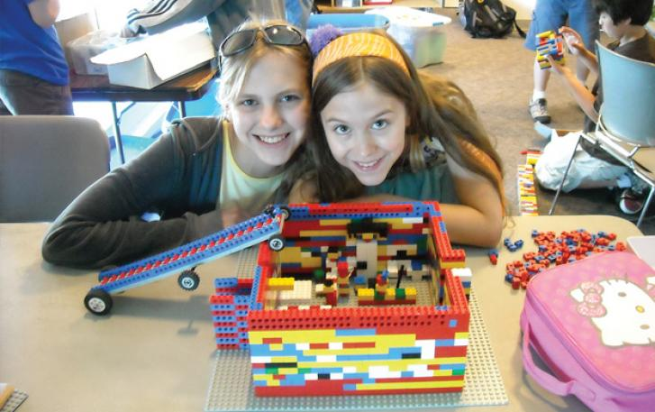 Student engineers displaying their LEGO® creations
