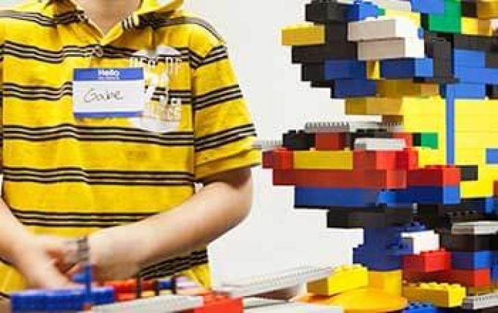 Student builder with LEGO® tower
