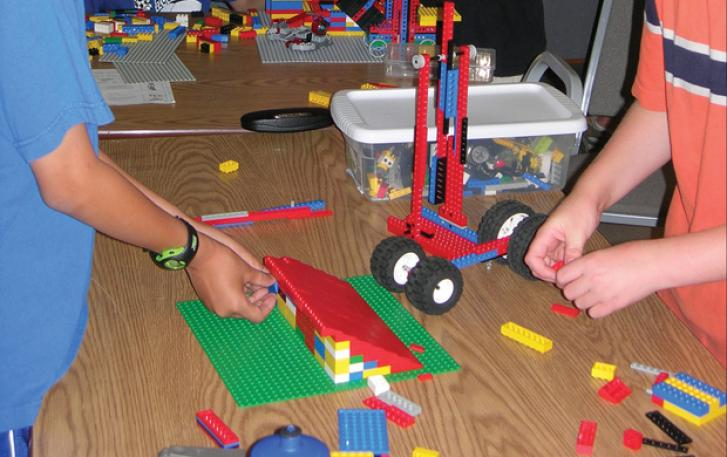 Students at work building a LEGO® vehicle and ramp
