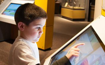 Child interacting with screen display