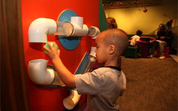Child in OMSI's science playground