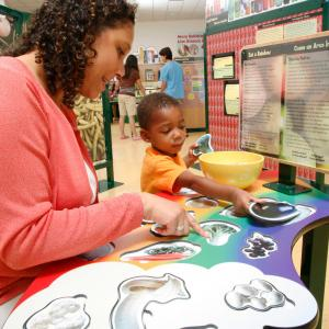 Visitors explore good nutrition at activity table