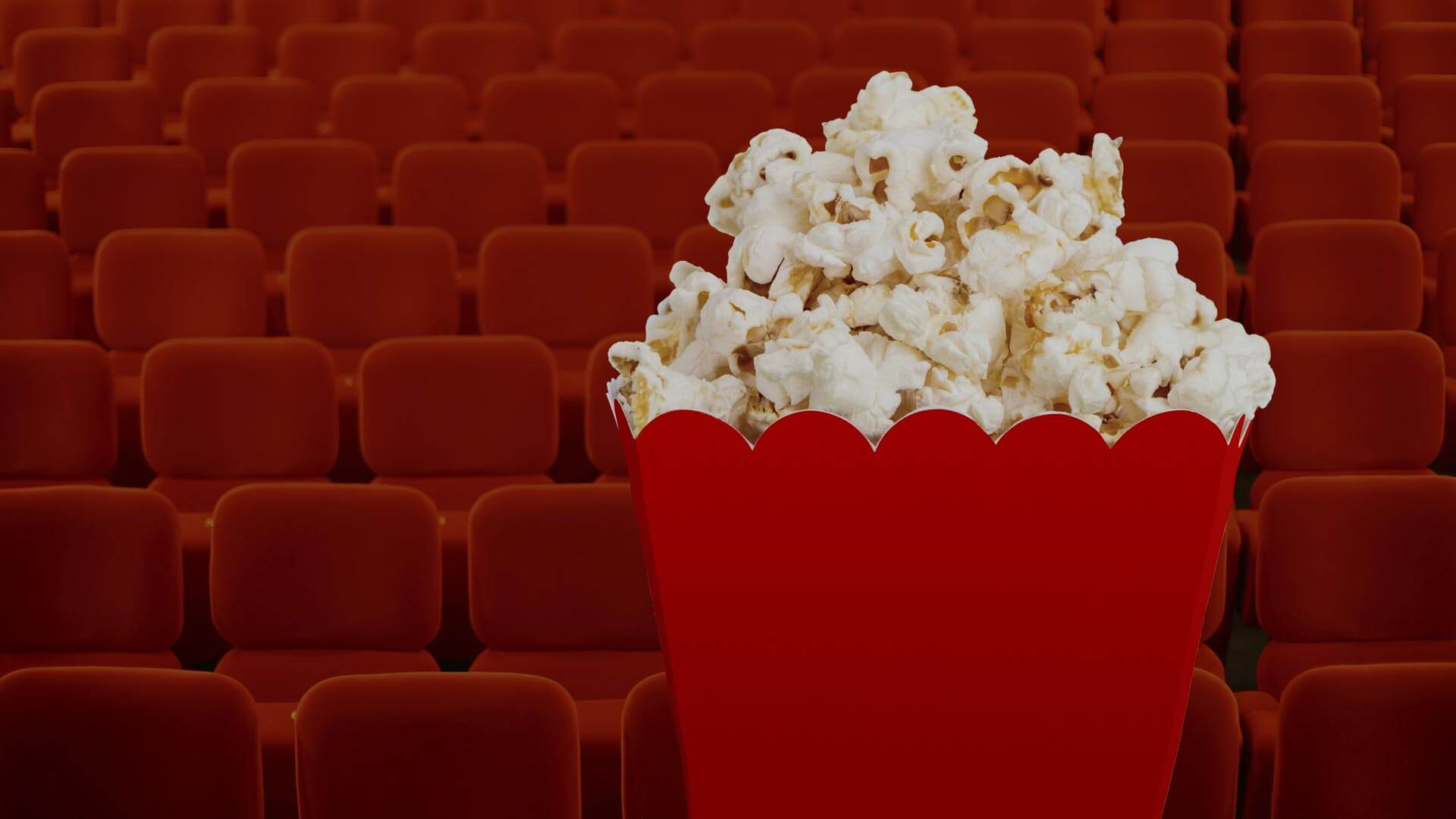 Red theater seats with popcorn